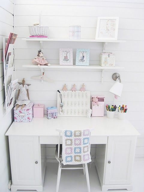 White walls, simple white desk and a few soft colored decorative items, for girl's room