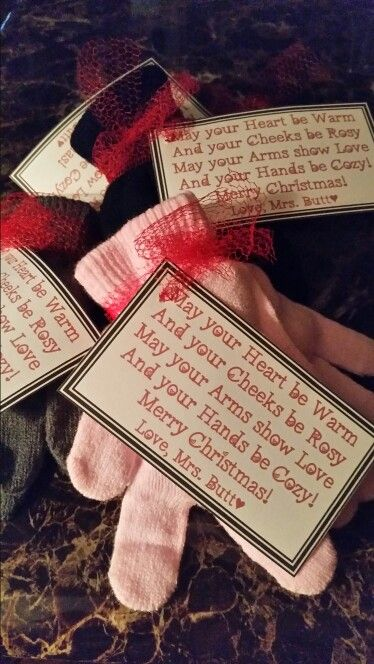 "A Christmas gift from Teacher!  I quickly thought of getting a pair of gloves (or mittens) filled with Christmas candy, chocolate Santa and Candy Cane with a poem that I wrote  attached: ""May your heart be warm, May your cheeks be rosy, May your arms show love, And your hands be cozy!"""
