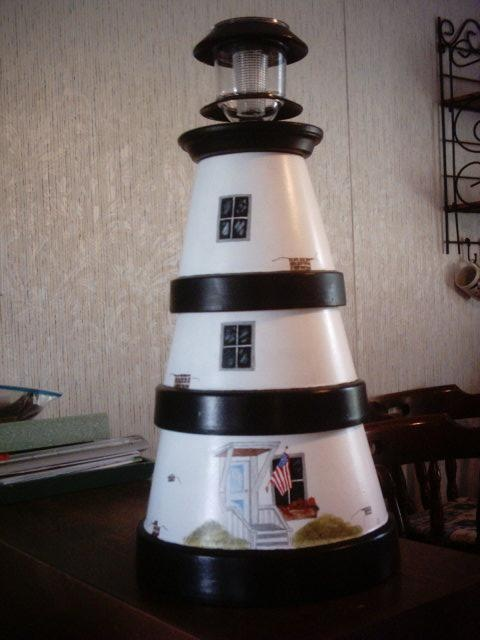 flower pot lighthouses | this is a lighthouse i painted using flower pots and a solar light in ...