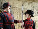 A Yeoman Warder and a boy dressed as a Warder