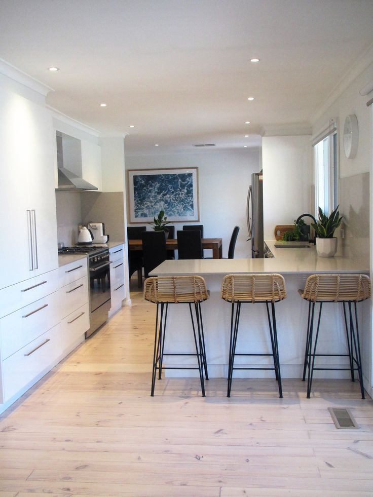 Everything in its Place - Contemporary white and gray kitchen, clam shell Caesar Stone bench splash back, lime washed timber floors, modern kitchen, modern gray kitchen, modern white kitchen, kitchen stools,