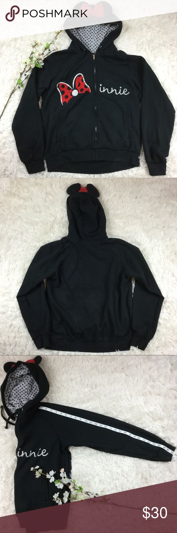 Minnie Mouse black zip up hoodie with ears Black Minnie Mouse hoodie with full front zip. Size L, approx measurements included above. Good condition hoodie, may have some fading to the fabric. Features Minnie on the front in soft textures material. Has polka dot print lined hood and classic mini mouse ears and re now. Open to offers or bundle with any other item to save instantly! Disney Jackets & Coats