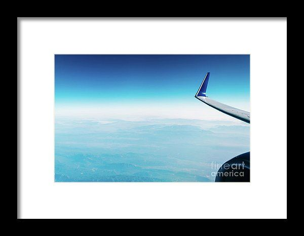 Airplane Wing View Above The Clouds Framed Print