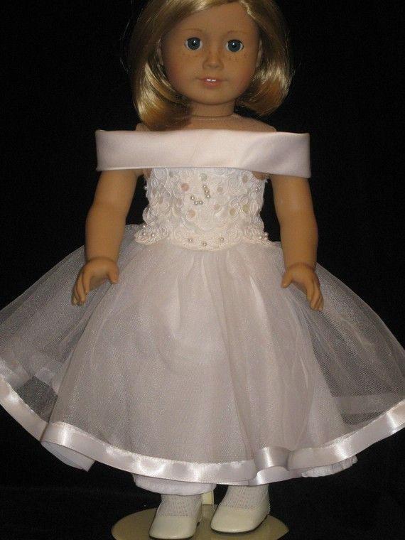 White dancing dress for American Girl Doll - OntheTownDesigns - Etsy - This white fancy dancing dress has a vintage flair. Two layer of soft net are edged in white satin ribbon. The bottom layer is white nylon. The beautiful bodice is covered with lace, sequins and pearls. The shawl collar is made of white satin and the back closure is velcro.