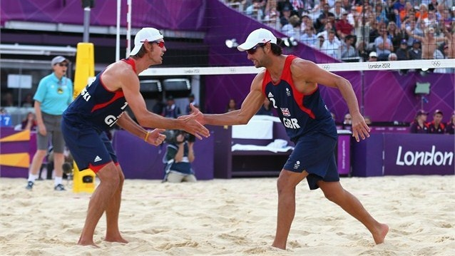 John Garcia-Thompson and Steve Grotowski of Great Britain celebrate during the men's Beach Volleyball Preliminary match between Brazil and Great Britain on Day 3.