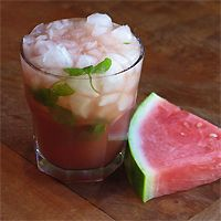Watermelon Mojito – 12 Bottle Bar Style  2 oz Pusser's Rum 1.5 oz Watermelon Juice 1.5 oz Lemon Juice 1 oz Watermelon-Balsamic Gastrique 2 oz Club Soda Handful of mint  Muddle mint in a large rocks glass, just enough to release the oils. Add rum, juices and gastrique. Give a quick stir. Fill glass with crushed ice. Add club soda. Stir. Garnish with a mint sprig or watermelon soldier, as desired.