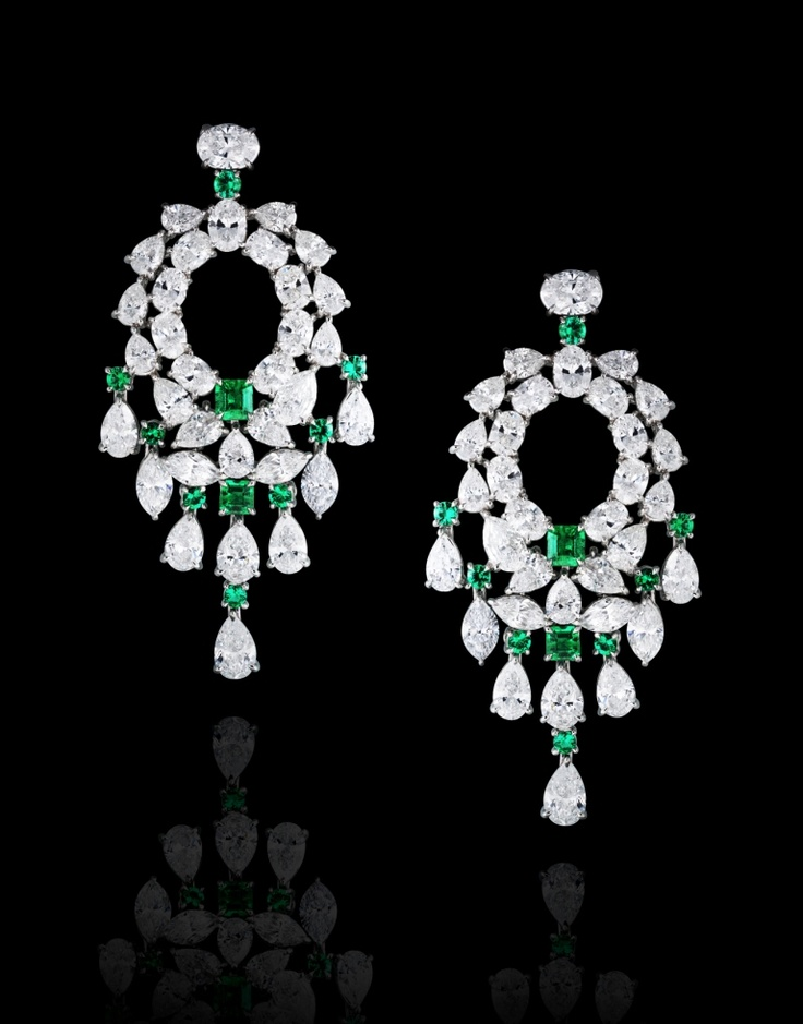 Four emerald and sixteen round-brilliant-cut Emeralds weighing a total of 2.20 carats mounted with pear, marquise and oval-shaped diamonds totaling 19.80 carats, handcrafted in 18 karat white gold.