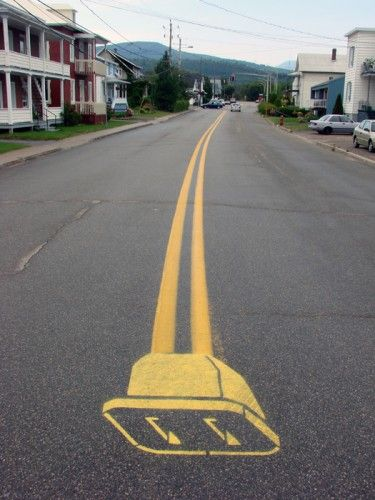Quebec artist Roadsworth / street art / plug (f)
