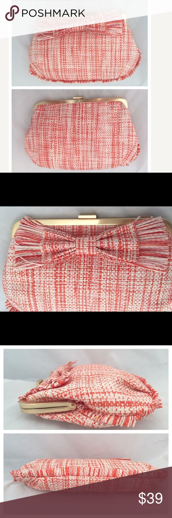 """J. Crea raffia orange clutch bag J. Crew raffia orange clutch bag with oversized bow and tiny fringes all around the bottom half. Gold tone metal opening. New with original tag. Canvas lined. Widest part is about 10"""" and height is about 6"""". J. Crew Bags Clutches & Wristlets"""