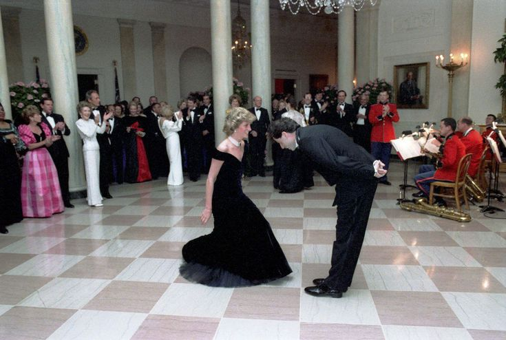 "During the gala, Diana danced with John Travolta (to the Saturday Night Fever soundtrack). So significant was the dance to the public perception of Diana that the dress she wore — a midnight blue evening dress created by designer Victor Edelstein — became known as the ""Travolta dress."""