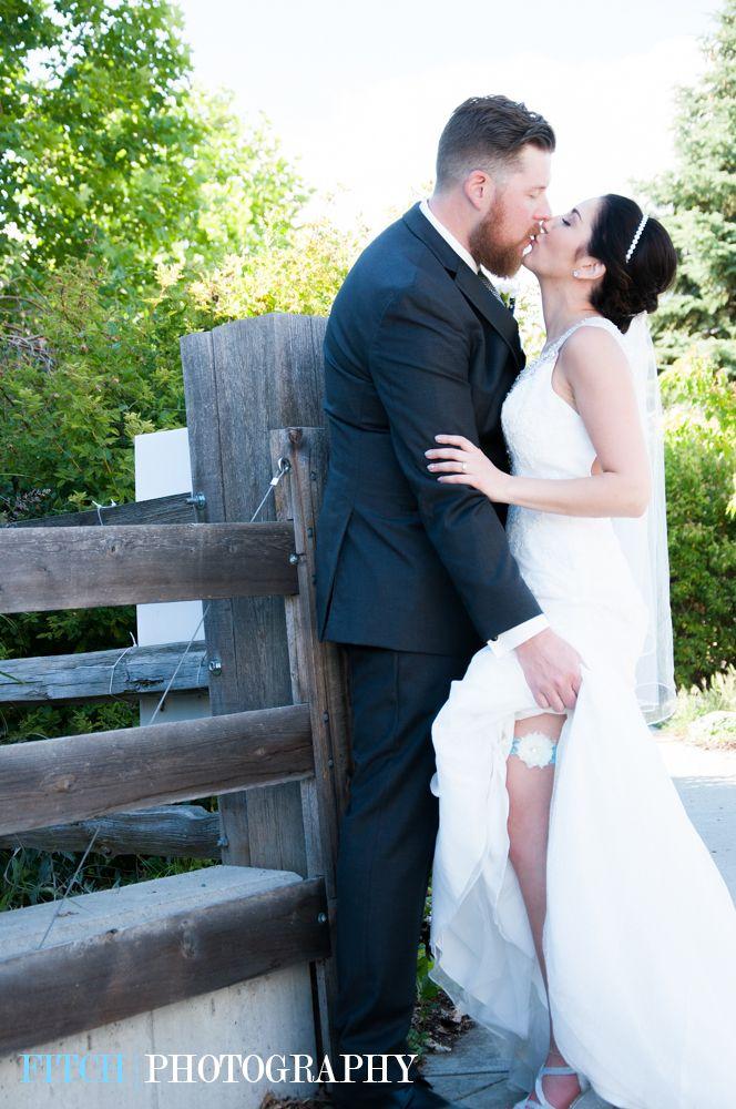 Showing off the garter! #somethingblue #weddingphotography #kiss