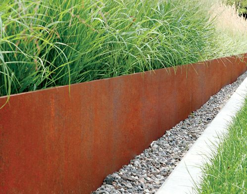 Corten Steel planter retaining wall planted with ornamental grasses - simple and effective