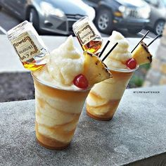 HENNY COLADA Hennessy Fresh Squeezed Orange Juice Fresh Pineapple Chunks Cream of Coconut Splash of Caramel