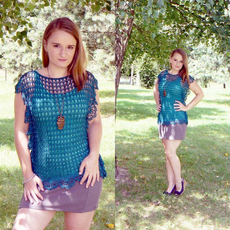 Dark turquoise crochet tunic with decorative edges.