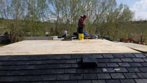 Photo shows Euroshield roofing on steep pitch connecting to flat roof.