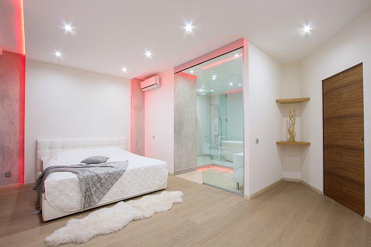 Feminine Red Also Pink Lighting Splash Installed Over White Painted Modern Studio Apartment Bedroom