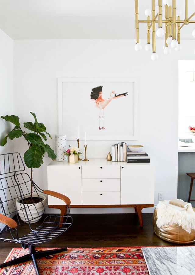 Fiddle leaf fig next to media stand to cover wires? Via Smitten Studio