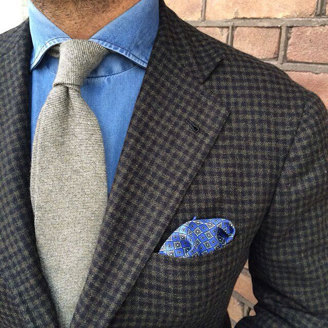 Brown and black guncheck sportcoat, denim shirt, light brown tie, blue silk p square