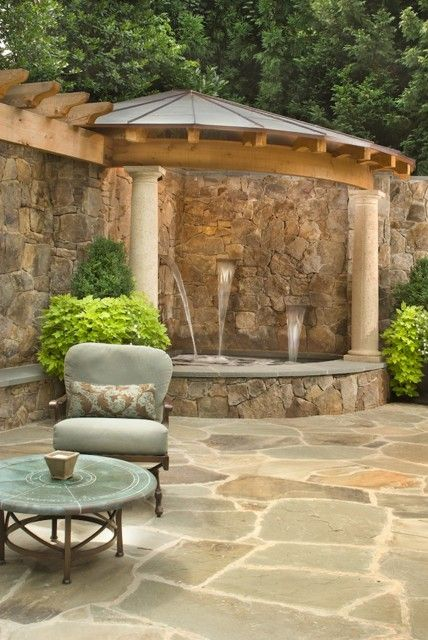 A discreet corner hot tub spa  fed by cascading fountains  is surrounded by  rock walls and covered with a roofed pergola in this beautiful backyard  oasis  67 best Relaxing Hot Tubs images on Pinterest   Architecture  . Corner Hot Tub Spa. Home Design Ideas