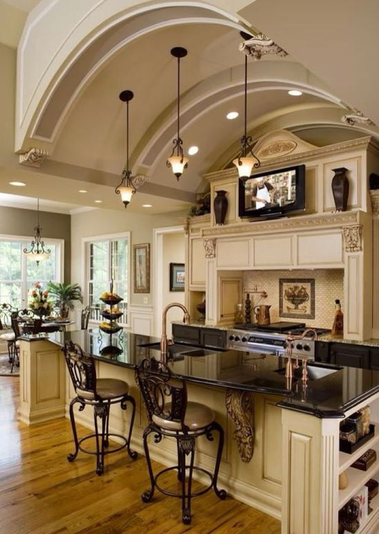 Mediterranean Kitchen with Limestone Tile, Kitchen island, Custom hood, Breakfast bar, Stone Tile, Pendant Light, One-wall