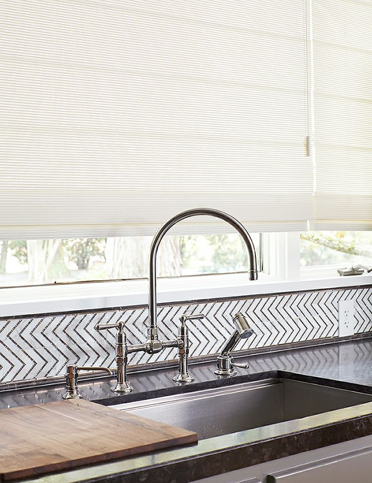 Stainless surfaces a striking chevron patterned mosaic for Motorized shades los angeles