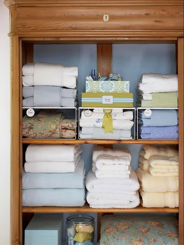 Linen organization.  Pillow cases wrapped around sheet set