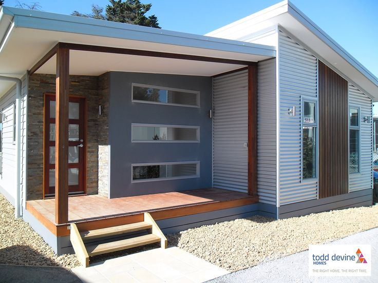 The Nicholson | Home - External cladding as James Hardie Newport Weather boards with Colorbond, Merbau Wood and Stone features.
