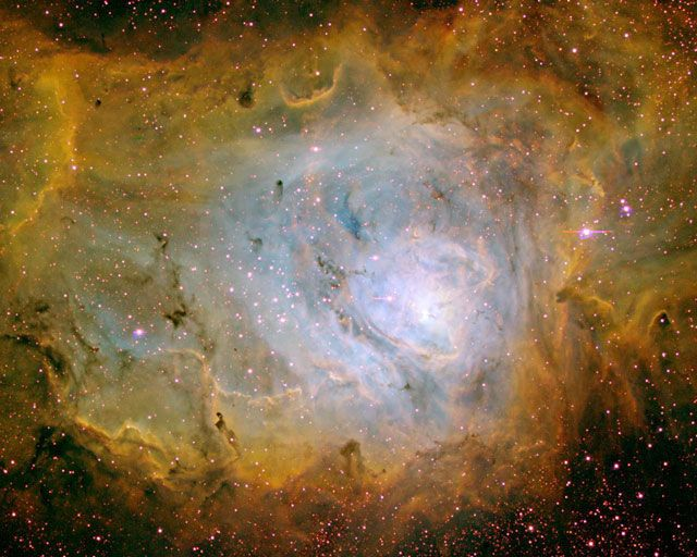 The Lagoon Nebula, also known as M8 and NGC 6523, lies about 5000 light-years away. The Lagoon Nebula can be located with binoculars in the constellation of Sagittarius spanning a region over three times the diameter of a full Moon.5000 Lights Years, 6523 M8, Lagoon Nebulas, Туманность Лагуна, Three Time, Full Moon, Nebulas Ngc, Three Colors, Ngc 6523