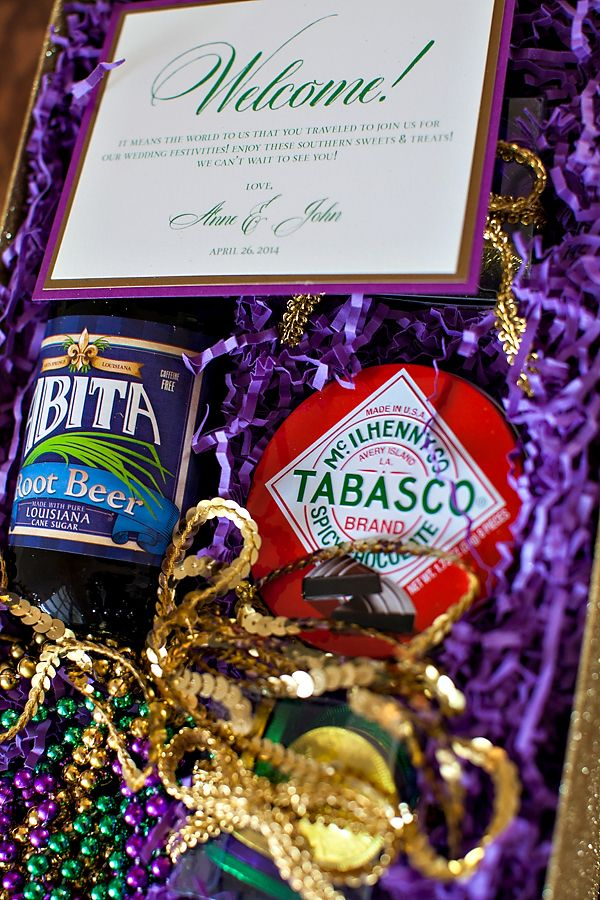 Mardi Gras wedding inspiration shoot | New Orleans Welcome Bag full of Louisiana Goodies: Abita Root Beer, Tabasco Chocolates, Mardi Gras Beads, & Chocolate Doubloons | Welcome note by Elisabeth Rose | Design and Styling by The Graceful Host | Photography by Old South Studios | Glitter box from Paper Source.