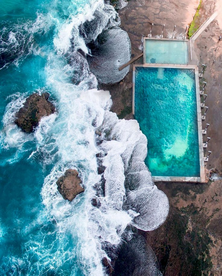 10/13/2016 Mona Vale Beach Pool Mona Vale, NSW, Australia -33.6787655, 151.3160979   Check out this incredible shot of the ocean pool at Mona Vale Beach, located in the suburbs of Sydney, Australia. There are a number of public ocean pools in New South Wales, offering stunning areas to swim, situated on the rocky coast, with waves splashing into the pool. Drone photographer: @gabscanu