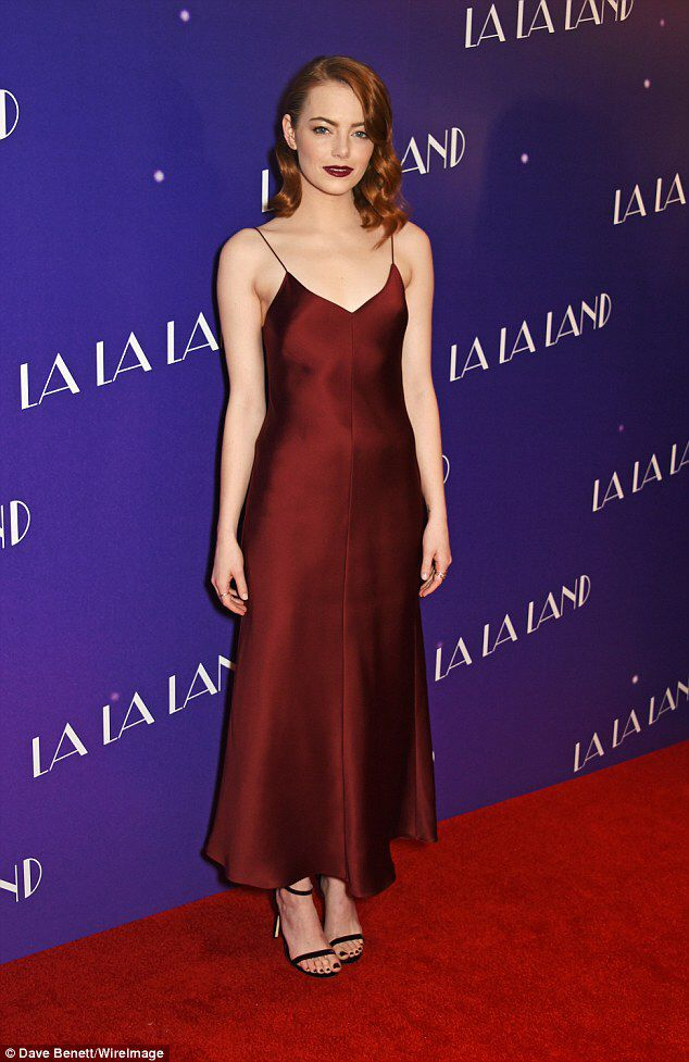 Emma Stone dons plunging slip dress for La La Land screening in London #dailymail