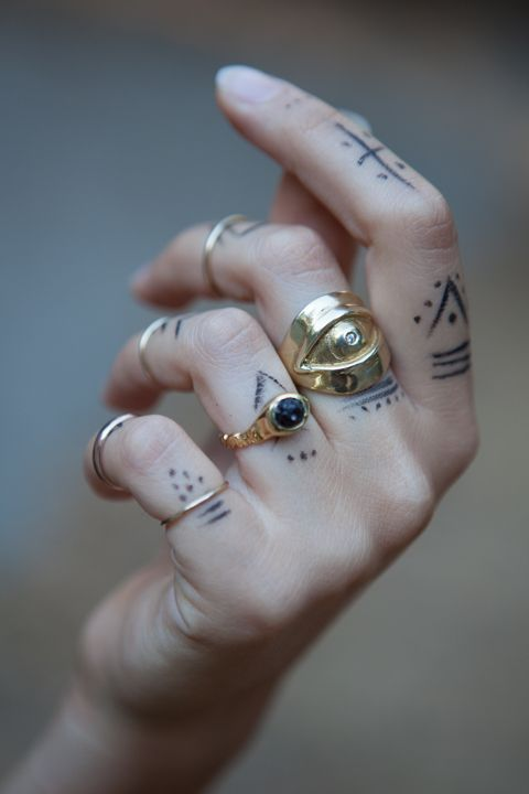 Hand tattoo.