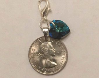 Traditional bouquet charm featuring an original lucky sixpence and a blue Swarovski Crystal heart attached to a length of organza ribbon so it can be tied to the bouquet .  Perfect for a Brides 'something old' and 'something blue' - £5.00 plus p&p