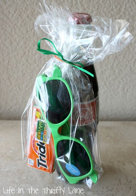 Birthday Party Favors For Teenage Boy...bottle of pop, gum & pair of sunglasses wrapped in a clear cellophane bag.