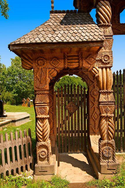 Traditional carved wooden Maramures folk art church gate at Breb, Nr Sighlet, Maramures, Transylvania