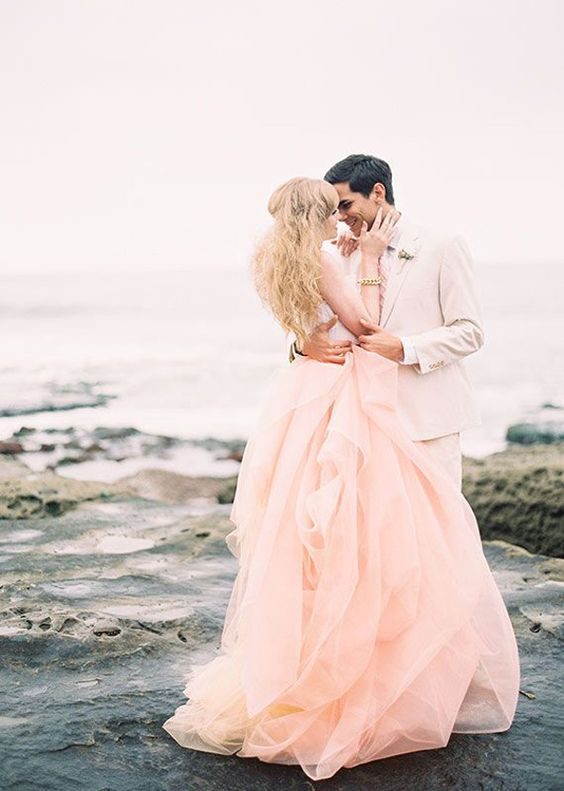 Some brides where non-white wedding dresses down the aisle, and that is quite alright. Pink wedding dresses would be the right one. Every girl has a pink dress dream, it is so fantastic if you realize your dream in your big day! Wish you have a happy pink bubble wedding ceremony and get inspired from the following gallery.