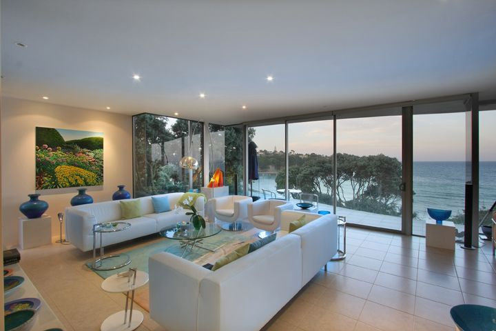 Murrays Bay House formal lounge with tranquil sea views