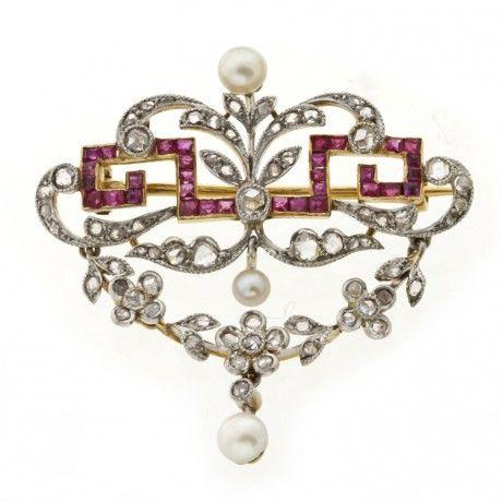 An Edwardian ruby, pearl and diamond swag brooch, circa 1900