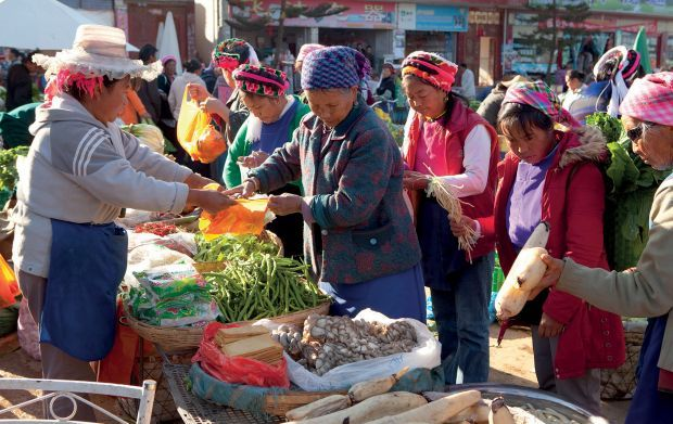 DALI YUNNAN, CHINA China's remote Yunnan Province is filled with ancient trading towns and the vibrant cultures of the region's many ethnic minorities. Markets in the ancient capital of Dali are accented with the bright colors and embroidery of the Bai people's traditional clothing.