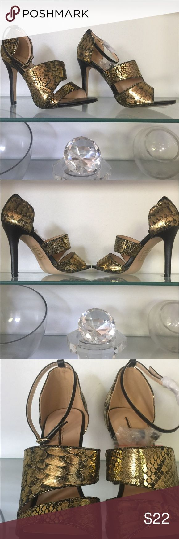 """NWOT Beautiful Ankle Strap Heels These beautiful black and gold shoes have the look of snakeskin but are soft to the touch two straps and an ankle strap closure accented with a black strip up the back for a clean accented look the thicker strap has a hidden piece of elastic to give the strap a little extra stretch. The heel is 4"""" high Shoes Heels"""