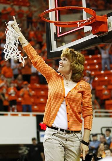 Congrats to OSU for bringing home a win! Shelley Budke, widow of OSU head coach Kurt Budke, points upwards after cutting down the last of the net after the OSU Cowgirls won the Women's NIT championship college basketball game between Oklahoma State University and James Madison at Gallagher-Iba Arena in Stillwater, Okla., Saturday, March 31, 2012. Kurt Budke and 3 others were killed in a plane crash on a recruiting trip in November of 2011. OSU won, 75-68. Photo by Nate Billings, The…