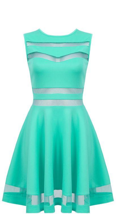 Elegancka miętowa rozkloszowana sukienka z siateczką