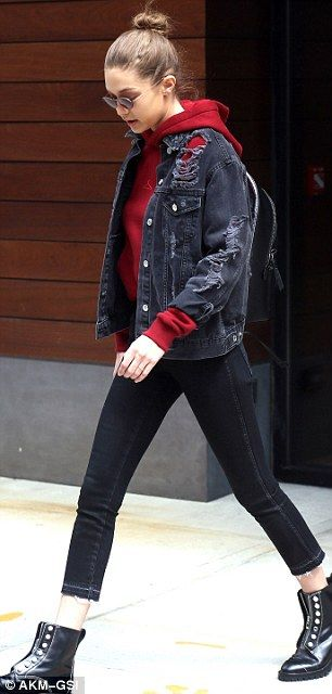 Later Gigi was seen in a red hoodie with black jeans and a black denim jacket. Black laceless boots added an urban jungle edge