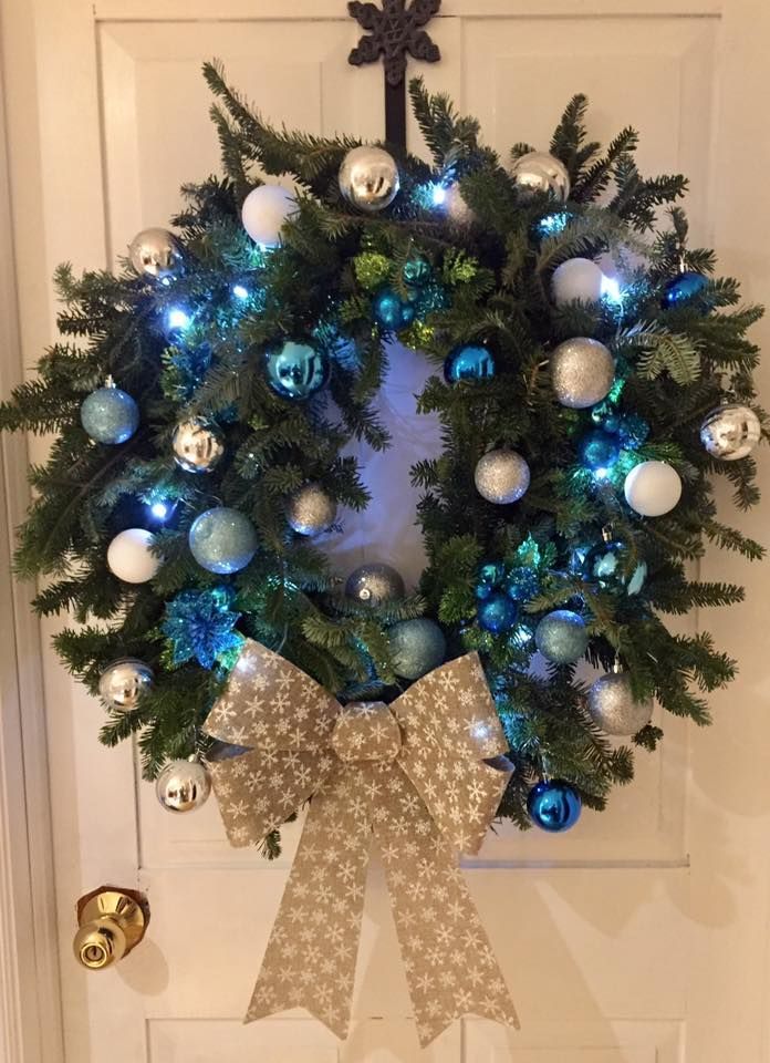 A classic pine wreath with blue and sliver ornaments! Perfect for an festive home!