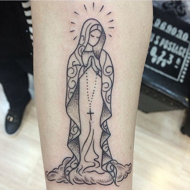 On right forearm wrapped around arm  Mary...