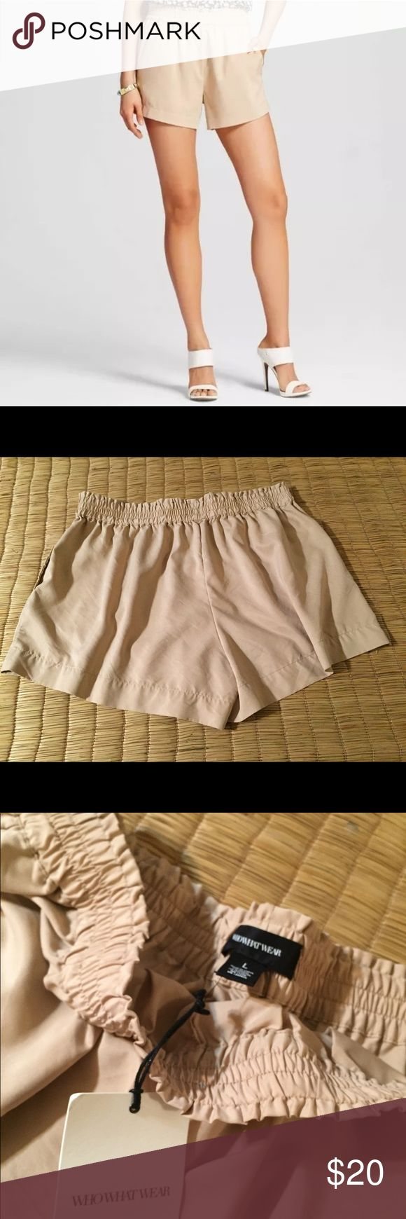 "Who What Wear Nude Smocked Shorts Elastic Waist OTHER DETAILS: Item is not lined and has an elastic waist // Pockets   APPROX MEASUREMENT(S):   Waist (corner to corner of top hem)  - 16""  Length (Total length )- 13.5""  Inseam -3.35"" This item was listed on: 8/30/17  💛Like this item for pricing updates    💛Items ship out ASAP (usually next business day)   💛Answer to Questions / Measurements asked for after 6pm Or on Sunday will be delayed but feel free to ask!   💛Save 15% by purchasing…"