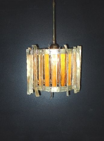 Handmade pendant lamp made of brass and pieces of colored glass.