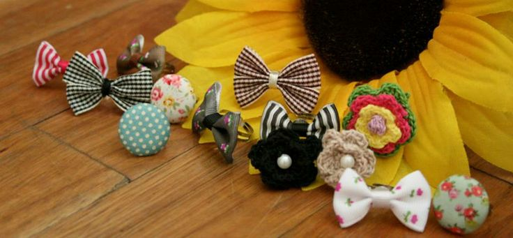 A collection of out bow and button rings.
