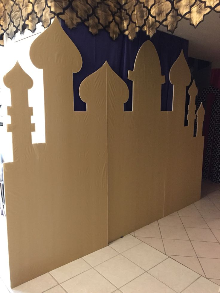Andrea's Arabian Nights: My own props: gold vinyl table cloth, Arabian cityscape, in process