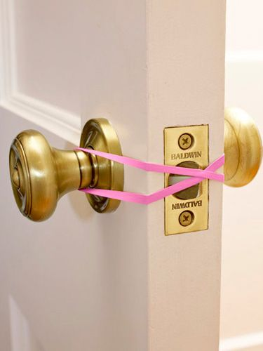 "Coming in and out with your hands full? Loop a single rubber band around a door's inside and outside knobs, twisting it as you do so that the ""X"" presses the latch open. Once finished, hang the band on the inner knob for the next time."